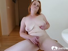 Older redhead woman is regarding to masturbate irrevocably