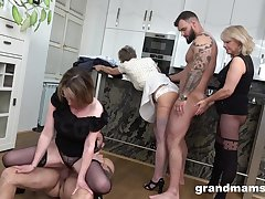 Venerable and young twosome couples having a fuck fest all over the kitchen