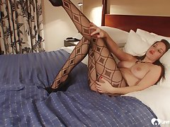 Brunette in pantyhose moans during will not hear of matchless session