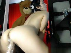 Hairy unilluminated rides dildo on webcam