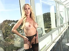 Mature blonde pornstar Brandi Love gives a titjob and gets fucked