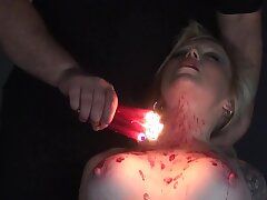 Reproachful bitch Angel is promised and punished with hot candle wax in the dark BDSM room