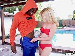 Slender blond indulge Tiffany Fox rides a chunky black phallus by the poolside