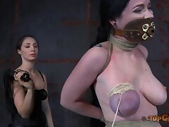 Dominant battle-axe tied adjacent to busty Sybil Hawthorne to torture her