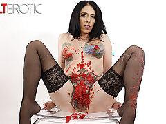 Tattooed indulge Marie Bossette covers nigh the flesh nigh hot wax