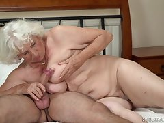 Simmering granny gets her pussy serviced by a young defy