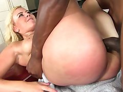 Fat breasted and big bottomed blonde nympho gets fucked away from black stud
