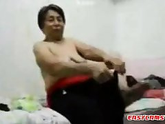Asian Grandma get dressed after mating