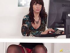 Mature slut gives a hot upskirt information while working on the brush computer